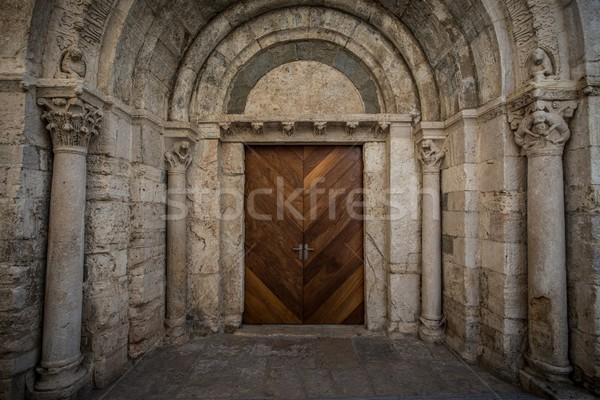 Wooden door in ancient archway Stock photo © Nejron