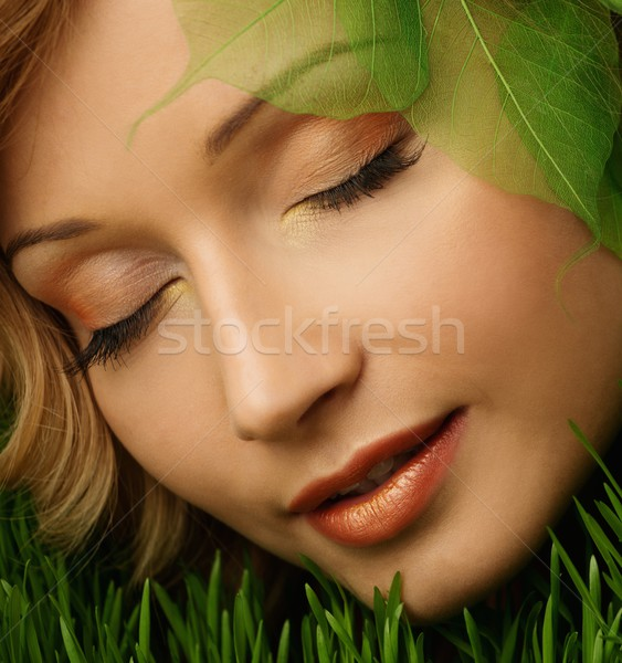 Dreaming young woman lying on a fresh spring grass  Stock photo © Nejron