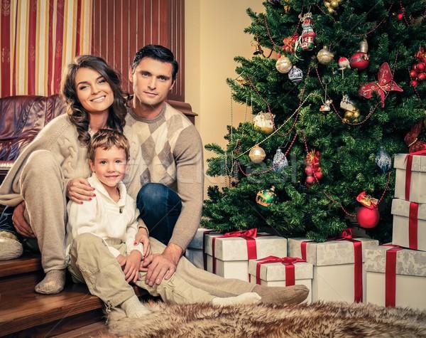 Stock photo: Happy family near Christmas tree in house interior