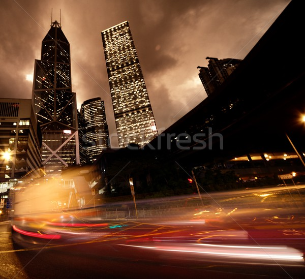 Fast moving cars at night Stock photo © Nejron