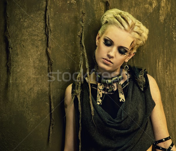 Blond girl against grunge wall Stock photo © Nejron