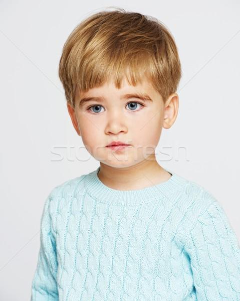 Pensieroso baby ragazzo blu pullover faccia Foto d'archivio © Nejron