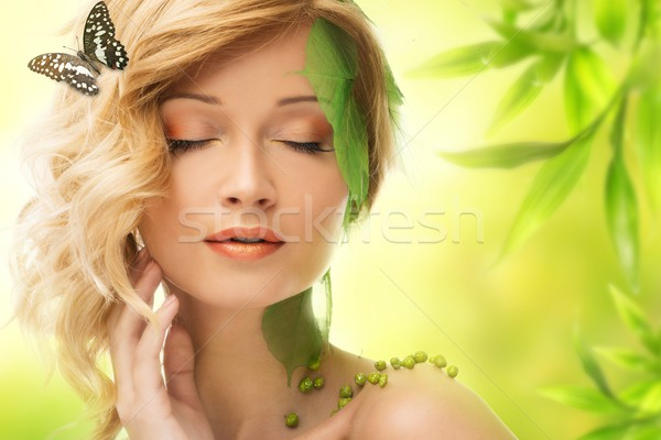 Beautiful young woman in conceptual spring costume with butterfly  Stock photo © Nejron
