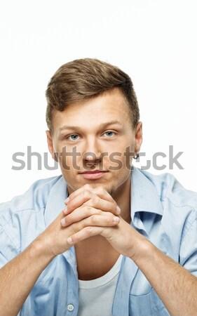 Elegante hombre azul camisa pendiente aislado Foto stock © Nejron