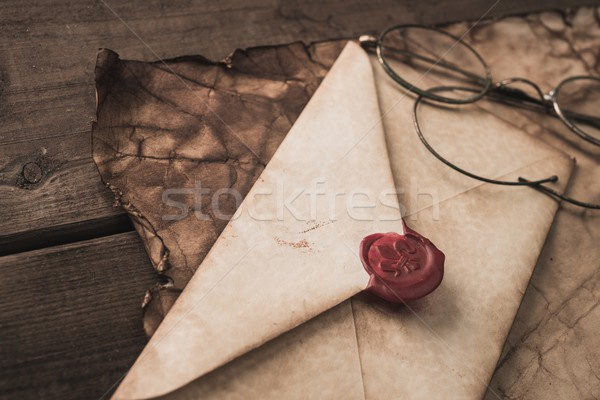 Envelope with wax stamp and glasses on a old paper Stock photo © Nejron