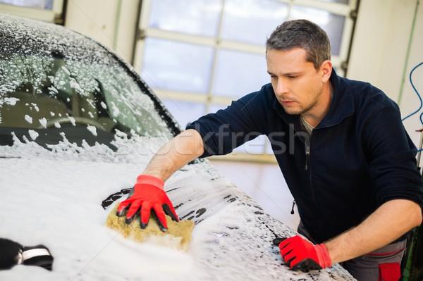 Homem trabalhador lavagem luxo carro esponja Foto stock © Nejron