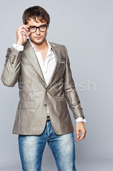 Stok fotoğraf: Moda · yakışıklı · genç · gülümseme · moda · gözlük