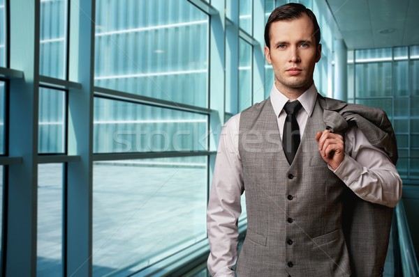 Man in grey suite in modern building. Stock photo © Nejron