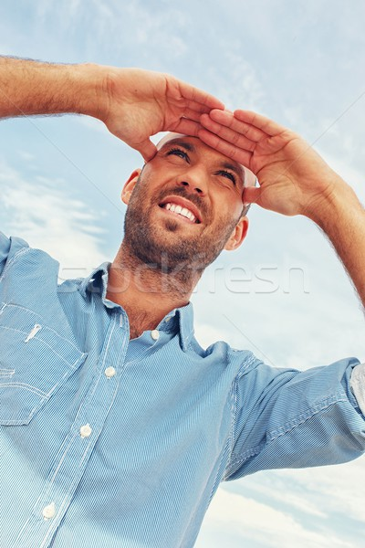 Positive middle-aged man outdoors against blue sky Stock photo © Nejron