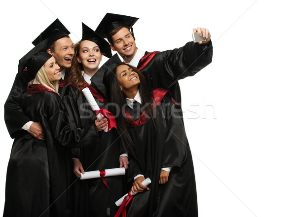 Multi ethnic group of graduated young students taking selfie  Stock photo © Nejron