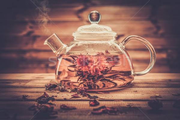 Verre théière floraison thé fleur à l'intérieur Photo stock © Nejron
