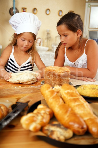 Two little girls trying to cook homemade pastry Stock photo © Nejron