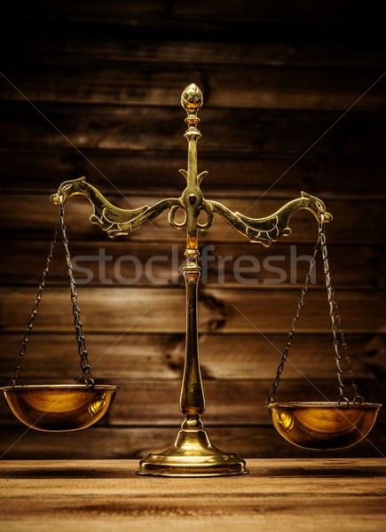 Brass scales over wooden background  Stock photo © Nejron