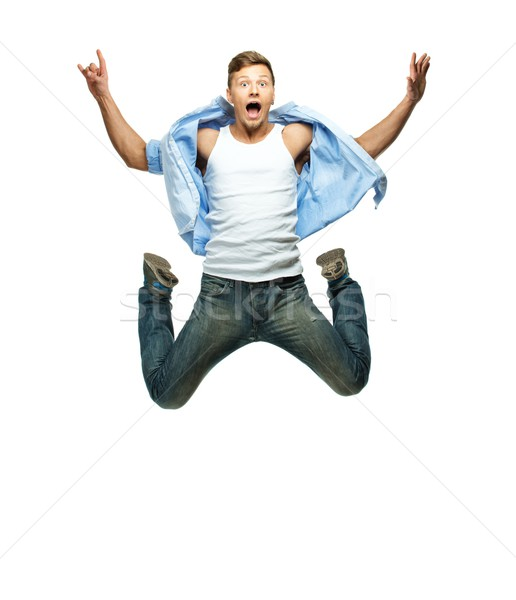 Funny man in blue shirt and jeans jumping  Stock photo © Nejron