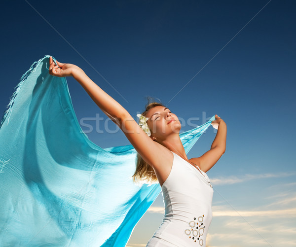 Beautiful young woman with a shawl relaxing outdoors Stock photo © Nejron