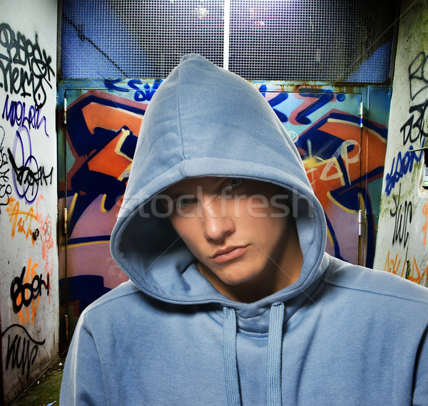 Cool looking hooligan in a graffiti painted gateway Stock photo © Nejron