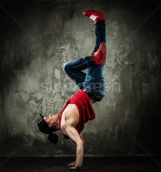 Man dancer showing break-dancing moves Stock photo © Nejron