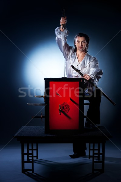 Sword box illusion Stock photo © Nejron