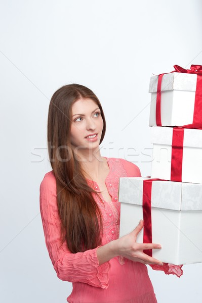 Stock photo: Beautiful brunette with a gift boxes.