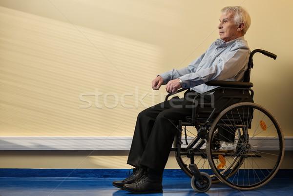Stock photo: Thoughtful senior man in wheelchair in nursing home