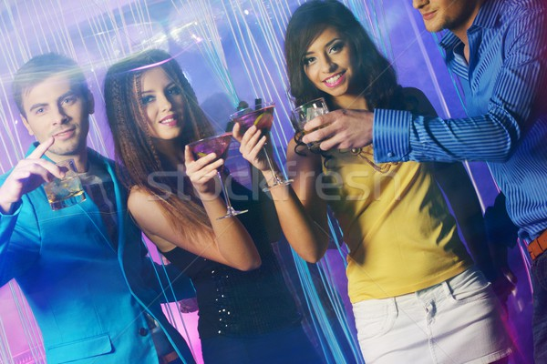 Group of happy young people dancing at night club  Stock photo © Nejron