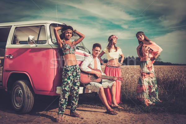 Multi-ethnic hippie friends with guitar on a road trip Stock photo © Nejron