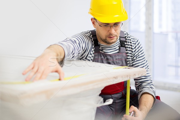 Workman measuring bathtub in new apartment interior  Stock photo © Nejron
