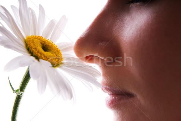 Girl smelling camomile isolated on white Stock photo © Nejron