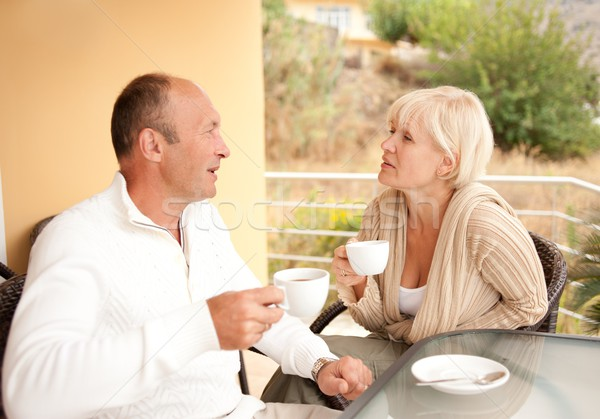 Middle-aged couple drinking coffee outdoors Stock photo © Nejron