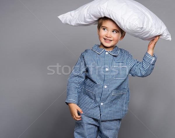 Weinig jongen Blauw pyjama kussen gezicht Stockfoto © Nejron