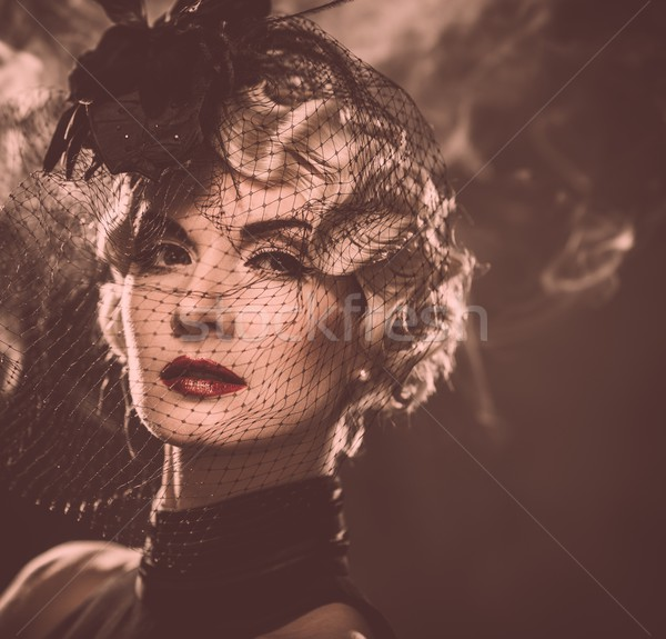 Elegant blond retro woman  with red lipstick wearing little hat with veil in smoke Stock photo © Nejron