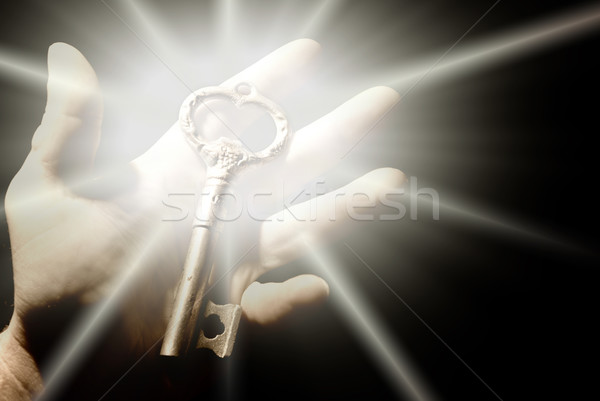 Human hand with an old key Stock photo © Nejron