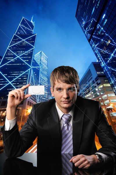 Young businessman against urban city view Stock photo © Nejron