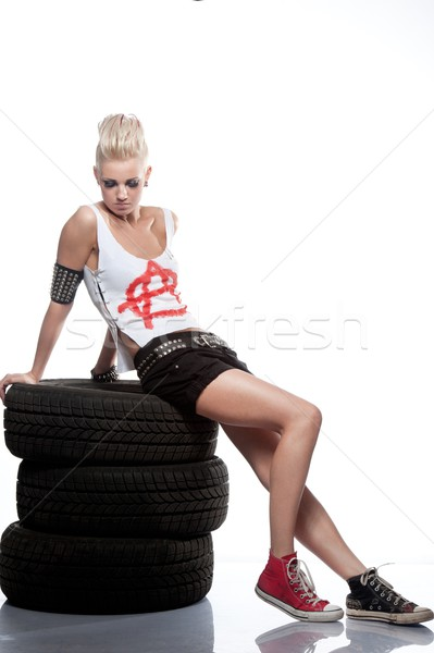 Punk girl sitting on a tires. Stock photo © Nejron