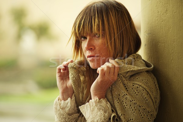 Attractive woman with freckles outdoors. Stock photo © Nejron