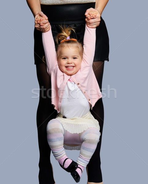 Mother swinging her happy little daughter  Stock photo © Nejron