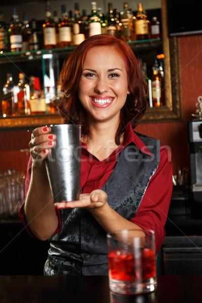 Beautiful redhead barmaid making cocktail Stock photo © Nejron