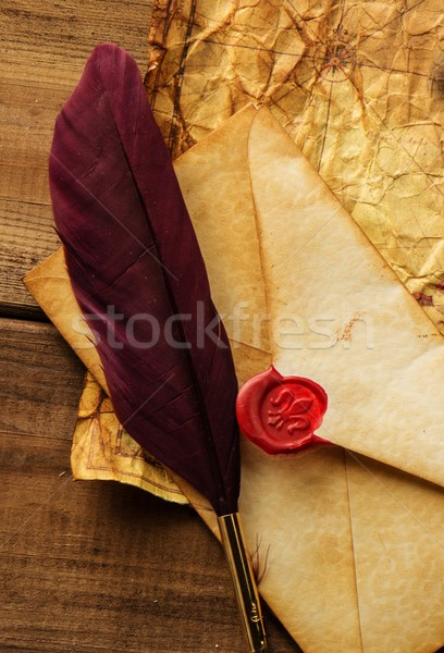 Envelope and quill pen on vintage paper over wooden background  Stock photo © Nejron