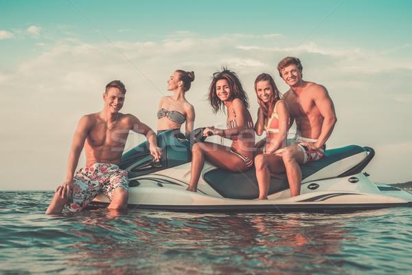 Csoport többnemzetiségű barátok ül jet ski égbolt Stock fotó © Nejron