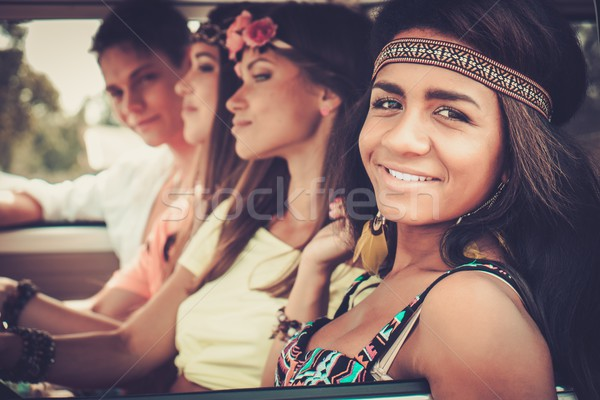 Multi-ethnic hippie friends in a minivan on a road trip Stock photo © Nejron