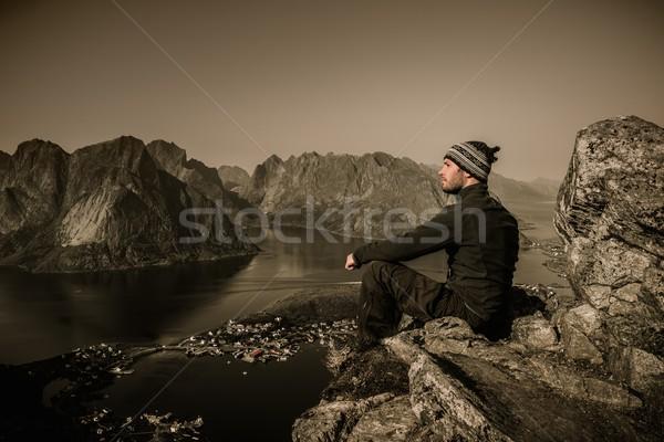 Man hiker looking at Reine village panorama, Norway Stock photo © Nejron