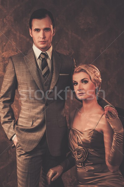 Well-dressed couple in retro interior Stock photo © Nejron