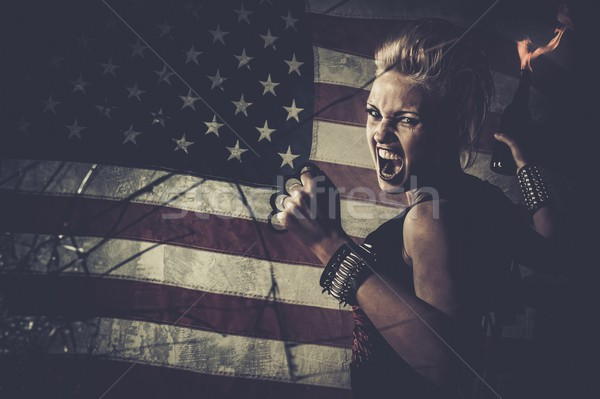 Punk girl against USA flag with brass knuckles and Molotov cocktail  Stock photo © Nejron