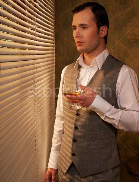 Man with a glass near a window. Stock photo © Nejron