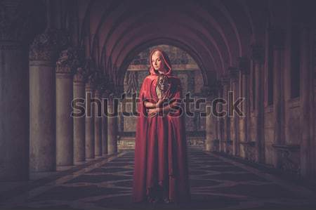 Woman with a mask wearing red cloak outdoor Stock photo © Nejron