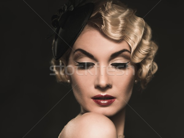 Elegant blond retro woman  wearing little hat with beautiful hairdo and red lipstick Stock photo © Nejron