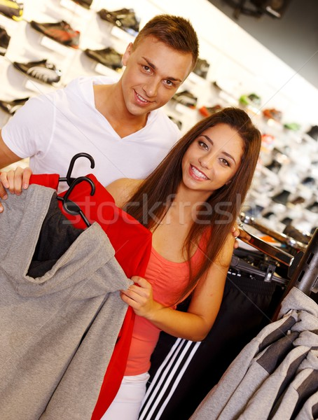 Beautiful young couple in s sport outlet Stock photo © Nejron
