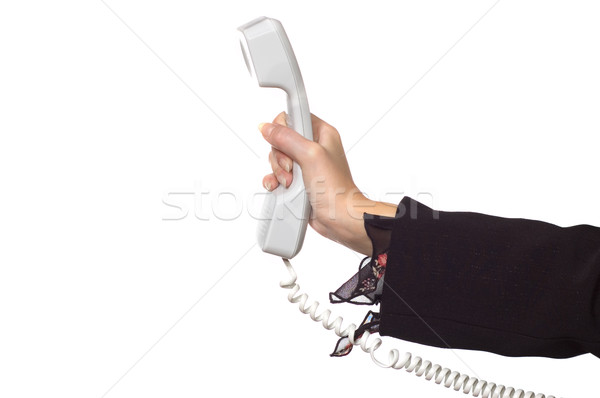Woman's hand with a phone receiver Stock photo © Nejron