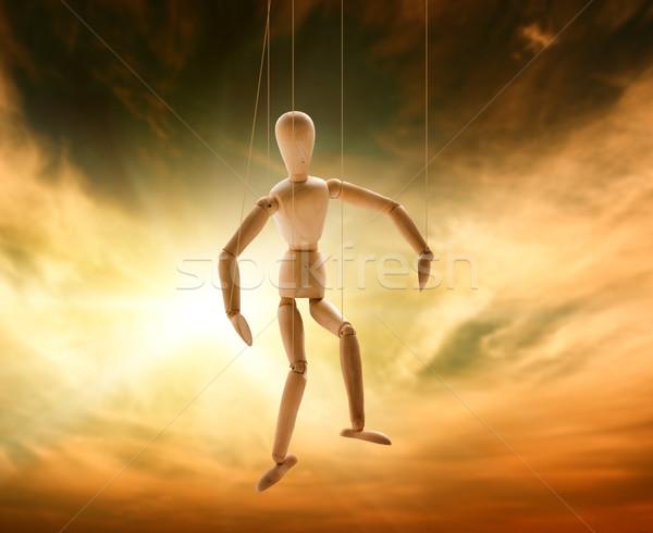 Fantoche homem madeira sol pôr do sol Foto stock © Nejron