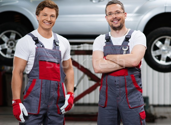 Two serviceman in a car workshop Stock photo © Nejron